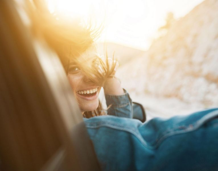 woman-smiling-while-being-car-ride